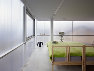 The owners, who are a couple with three children, requested a bright home with a gentle, pervasive light that is far from cold.