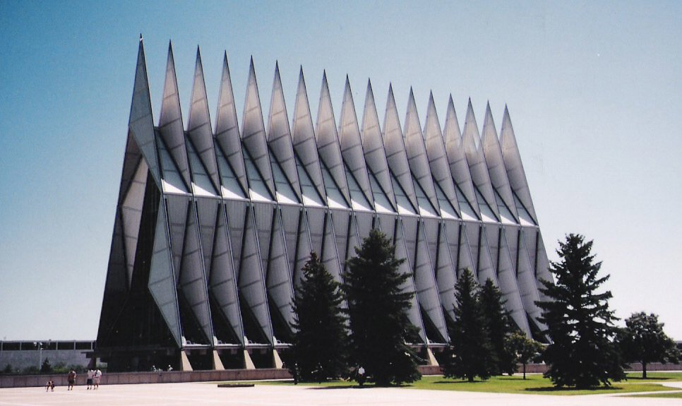 Walter A. Netsch Jr., Cadet Chapel (1959)  Looking more like a space-age battleship than a house of worship from certain angles, architect Walter A. Netsch Jr.'s futuristic temple is an angular assemblage of five-ton metal tetrahedrons, built out of the same aluminum panels as jet fighter wings. Winner of the American Institute of Architects' 25 Year Award and a United States National Historic Landmark, the set of 17 spires might as well be a squadron screaming towards the heavens.   Photo courtesy David, Creative Commons  Photo 6 of 10 in 10 Inspiring Modern Churches