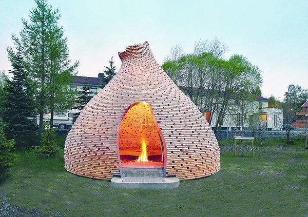 Haugen/Zohar's salvaged-wood Fireplace for Children, in Trondheim, Norway, serves as a sheltered place for storytelling. Photo by Haugen/Zohar Arkitekter/TASCHEN.