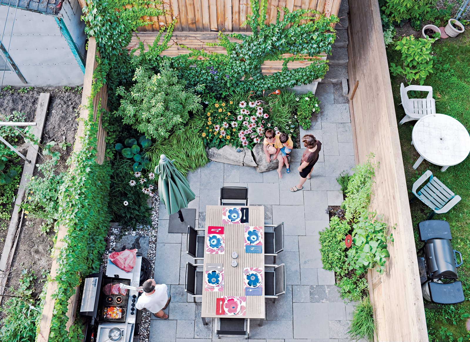 Outdoor, Back Yard, Gardens, Walkways, Stone Patio, Porch, Deck, Horizontal Fences, Wall, and Wood Fences, Wall Chong left enough space in the 16-foot-wide backyard for a garden and comfortable dining area.  Best Photos from Narrow Modernist Three-Story Home in Toronto