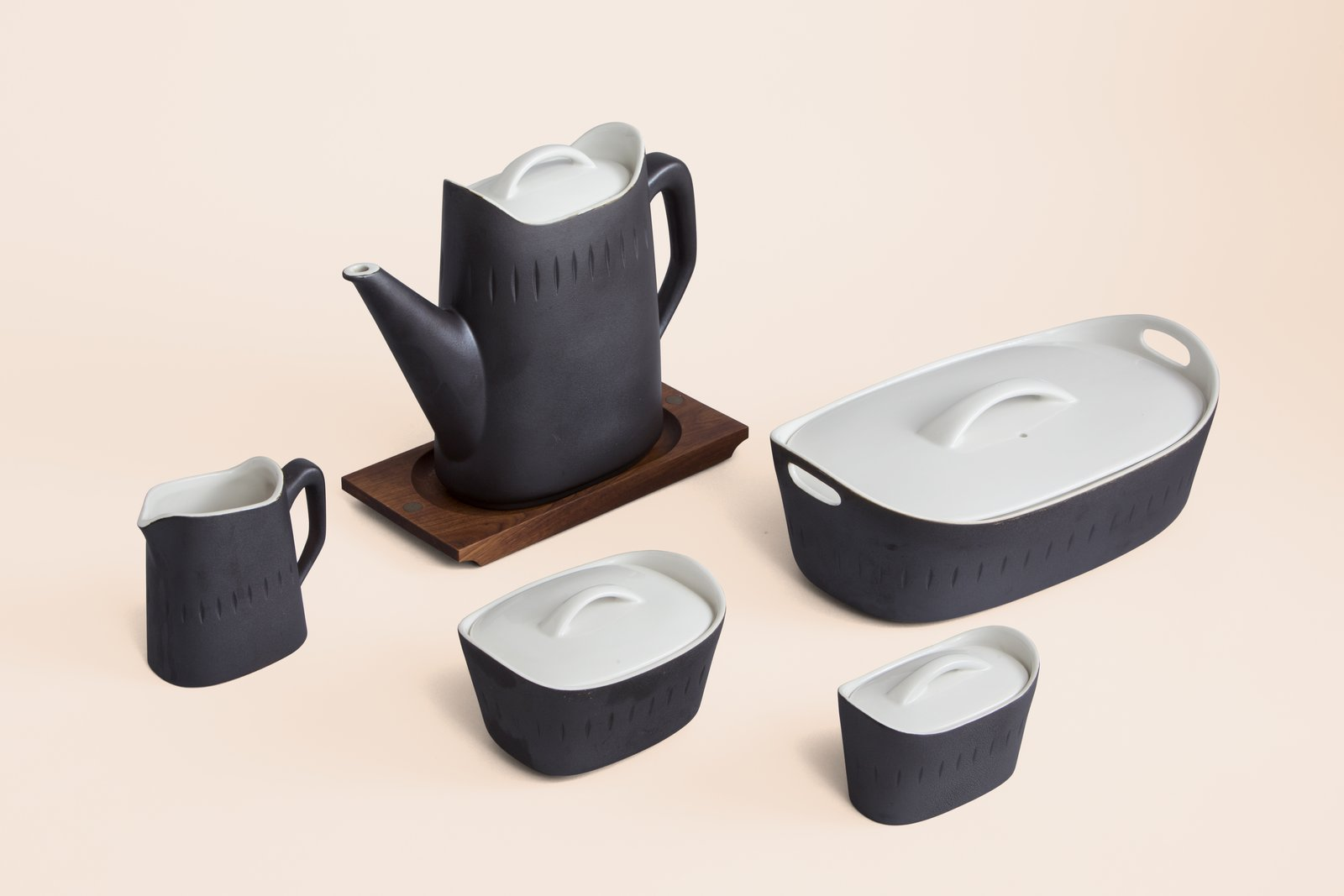 """German designer Ernest Sohn created household products such as lazy Susan trays, candlesticks, and fruit bowls after emigrating to New York in 1936. The """"Esquire"""" coffee pot set and casserole dishes from 1963 feature matte-black exteriors and shiny white interiors and lids. Photo by John Halpern.  Photo 3 of 6 in Jewish Designers' Influence on Midcentury Modernism"""
