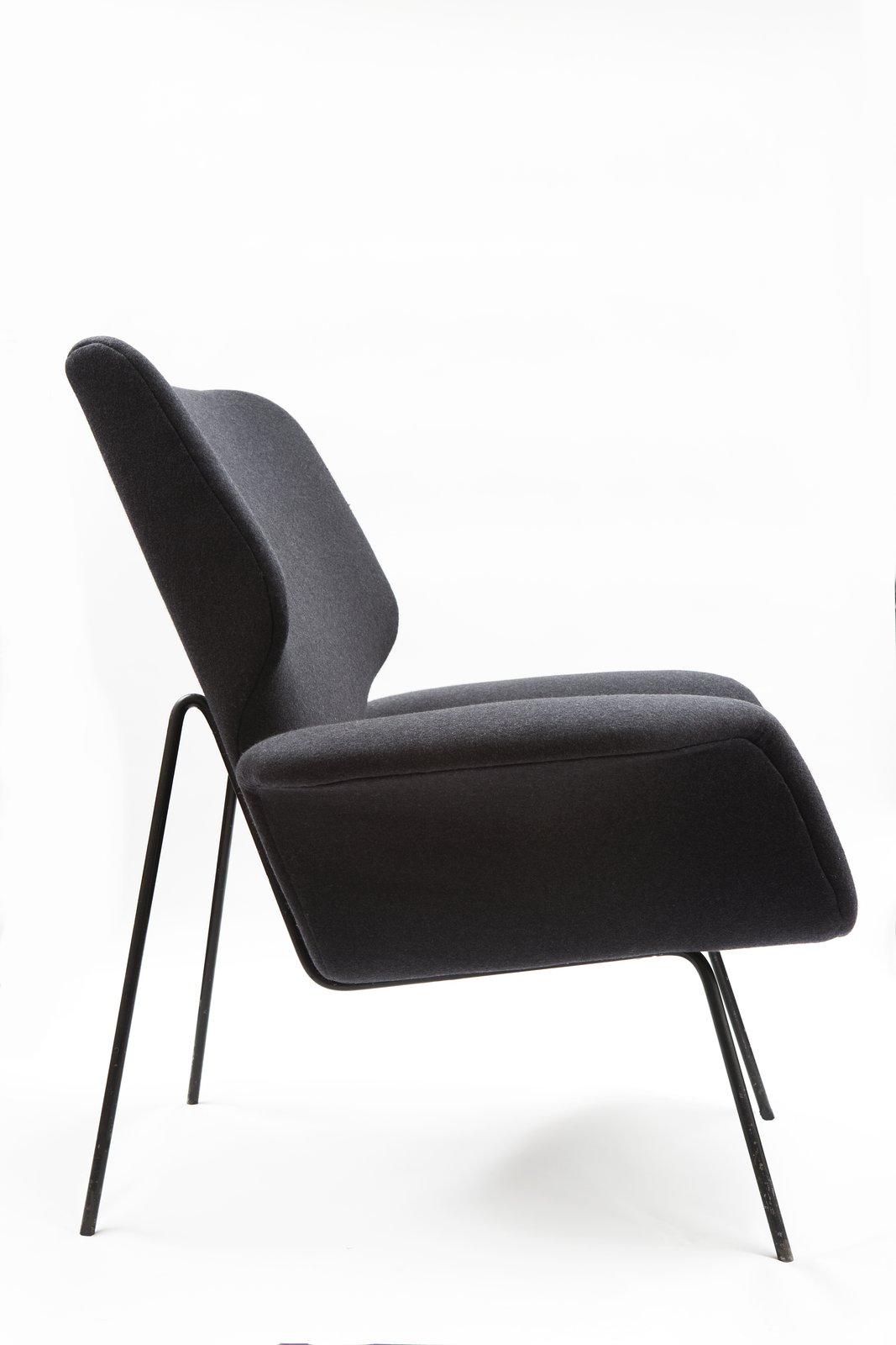 Graphic designer Alvin Lustig, known for designing more than 70 book covers in his lifetime, ventured into furniture and interiors later in his career. Upholstered chair for Paramount Furniture, 1949. Photo by Conner/Healy.  Photo 4 of 6 in Jewish Designers' Influence on Midcentury Modernism