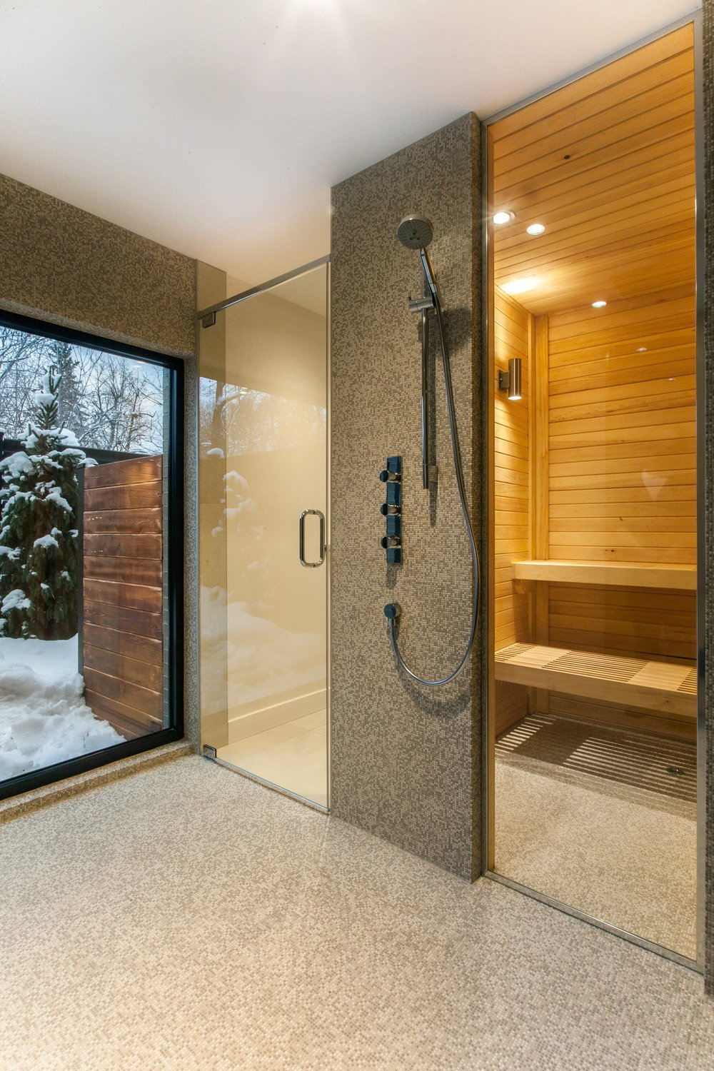 Bath Room and Enclosed Shower The renovated house is outfitted with a sauna.  Photo 9 of 10 in 10 Sterling Saunas in Modern Homes from Near Montreal, a 1950s House Gets a Modern Makeover