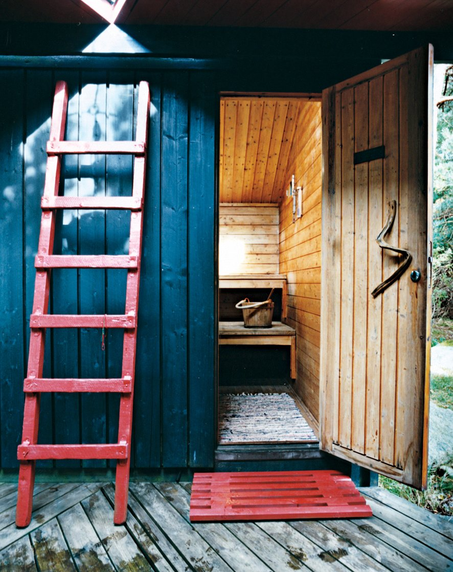 """Shed & Studio The sauna door handle is a simple piece of driftwood. """"One principle rule I followed,"""" says Kiehl, """"was: Don't build on outdoor space if it can work as outdoor living space. Norwegian summers are short. We want to be outdoors as much as possible.""""  Photos from Norwegian Wood"""