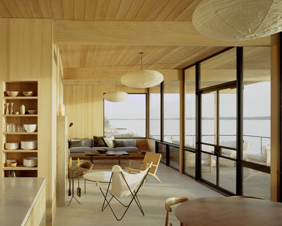 "Living Room Inside, the kitchen, dining and living areas are separated by breezeway from the master suite and the children's bedrooms. ""It's small,"" Cary said. ""I wanted to design it, but not architect it."" Courtesy Architects and Artisans.  Shelter Island Retreat by J. Michael Welton from Long Island Homes We Love"