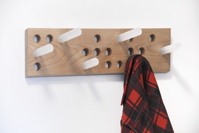 """Patère Coat Rack by Les Archivistes  """"The name of the piece is spelled out in braille on the coat rack, and the acrylic posts can be customized. It's a great tactile feature, and it's just clean and quite engaging."""" -- Julie Nicholson  """"The word 'patere' has several meaning in French that don't quite translate into English, so we really can't quite understand it."""" -- Shaun Moore  Photo 3 of 10 in Shops We Love: MADE"""
