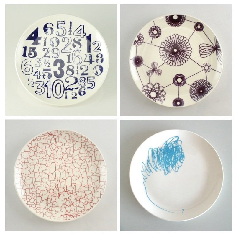 """Redesigned Medalta Side Plates by Medalta  """"Medalta is an historic site that was once the home to several potteries, and is known for quality porcelain. The factories went bankrupt, and thousands of these plates were left. Contemporary designers then made patterns that translated onto these plates. It's now actually an active artist's residency program."""" -- Julie Nicholson  """"Its in Medicine Hat, Alberta. The imagery on the plates actually relates to the site. We're the only store in Canada that carries these."""" -- Shaun Moore  (Designers clockwise from top: Jenna Stanton, Jenn Demke-Lange, Aaron Nelson & Tobie Laliberte)  Photo 9 of 10 in Shops We Love: MADE"""