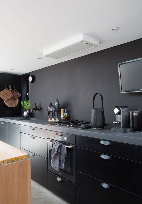 A matte black kitchen is perfectly in step with the Scandinavian style in this houseboat in the Netherlands. Via The Style Files  Kitchen from Links We Love May 2, 2014