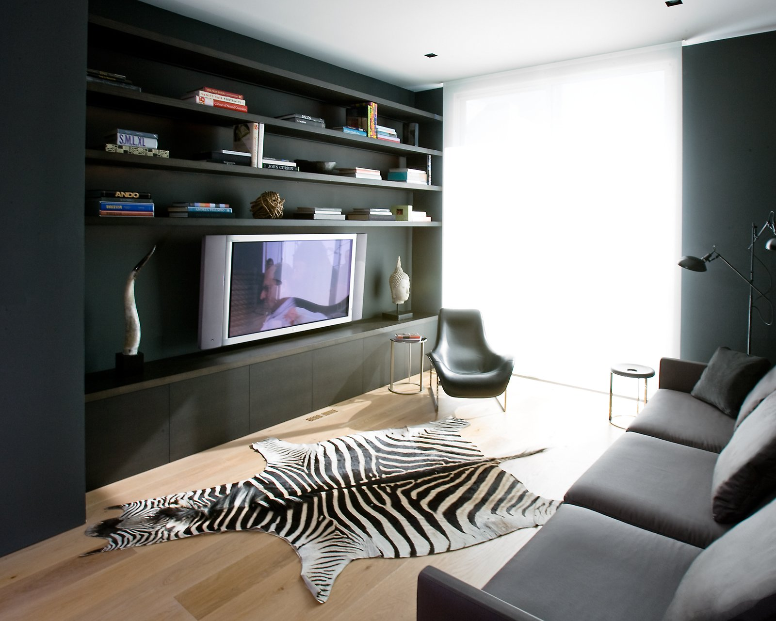 The media room is all about relaxing, whether in the nine-foot-long, extra-deep sofa from Minotti or the lounge chair from B&B Italia.Photo by   Ben Mayorga Photography  Photo 7 of 10 in Pacific Heights Remodel