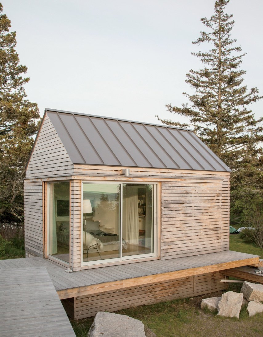 """""""We did our best to tuck the buildings into the site—the goal was to get up high on a perch. It was a matter of setting that elevation and working back down with the topography.""""—Riley Pratt, architectural designer Tagged: Exterior, Cabin Building Type, Gable RoofLine, Wood Siding Material, and Metal Roof Material.  Bedrooms by Dwell from A Cluster of Cabins in a Former Quarry Makes a Simple Vacation Escape"""