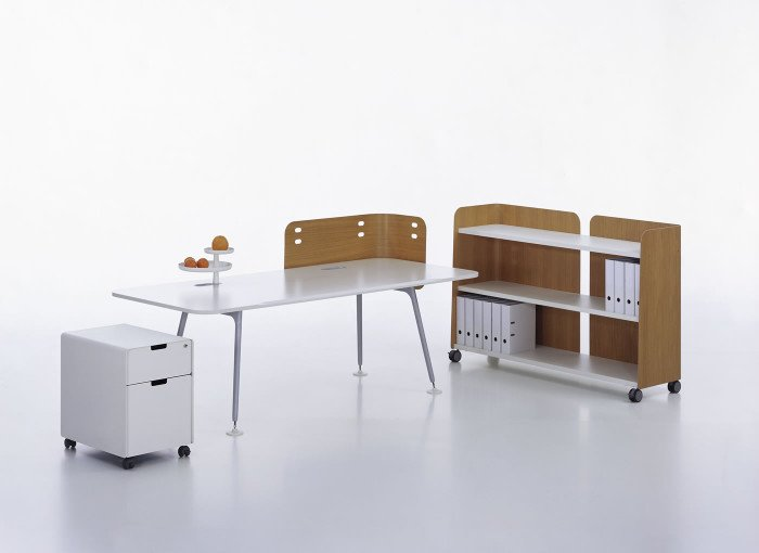 A far cry from the standard-issue functional, flaccid cubicle, Morrison's ATM System brought stylish curves and wooden accents to the modular office life.  Photo 9 of 12 in Design Icon: 10 Works by Jasper Morrison