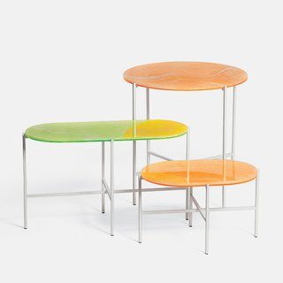 Neon tables by Sebastian Herkner for Haymann, $1,660.  Thin layers of white onyx are placed atop acrylic to achieve an acid-washed look for the steel-legged tables.