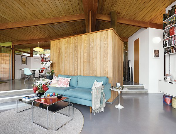 This midcentury gem lays in Crestwood Hills, in the Brentwood neighborhood of Los Angeles, an endangered enclave of midcentury post-and-beam houses designed by A. Quincy Jones and Whitney R. Smith. Elise Loehnen and Rob Fissmer bought their house, which dates to 1950, in 2012, furnishing the living room with a Jasper sofa by Room & Board, Laccio tables by Marcel Breuer, and a wool sisal rug from Madison Flooring and Design.