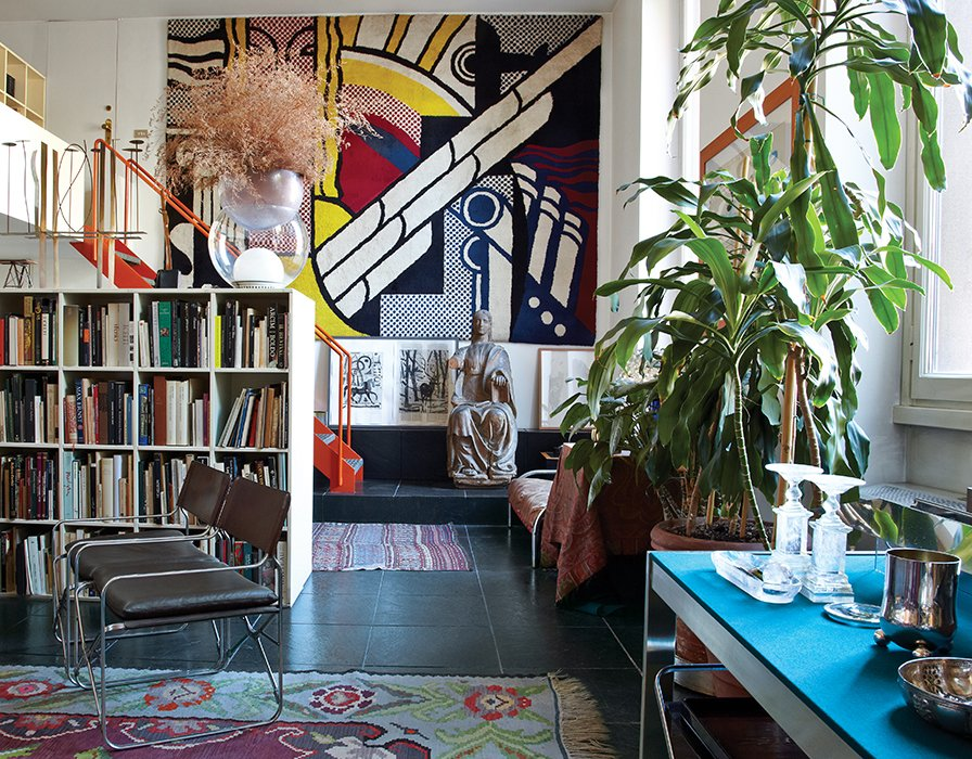 A limited-edition Roy Lichtenstein carpet dominates one wall of designer and architect Gae Aulenti's living room in Milan. She lived in this Brera apartment, mostly furnished with her own designs, such as her 1964 April folding chairs for Zanotta—from 1974 until her death in October 2012.  Photo 1 of 6 in The Elegant Milan Home of Designer Gae Aulenti