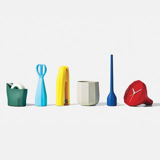 Babylon collection by Samuel Wilkinson by Lexon. Inspired by rocks, these faceted desktop accessories—tape dispenser, scissors, stapler, cup, pen, and alarm clock—are made of injection molded plastic.