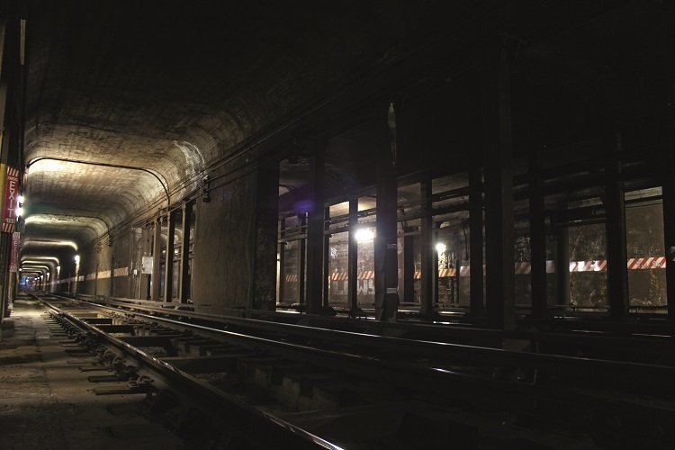 Red and white panels on track walls indicate areas of no clearance in which an individual will be hit by the train  Photo 8 of 10 in Beneath the Streets: Photos of New York's Secret Underground
