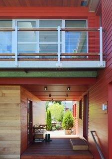"""A """"bridge"""" houses the bedrooms and spans the main living area and the garage. Photo by Eric Roth."""