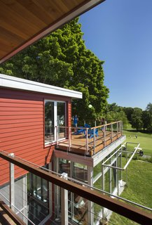 An outdoor deck gives the family a place to congregate when the weather cooperates. Photo by Eric Roth.
