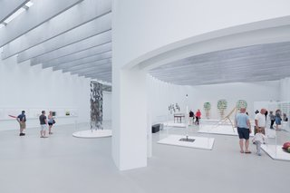 Designed by Thomas Phifer and Partners, the museum was recently awarded the AIANY Design Award for the wing. Curved white walls guide the visitor through free-standing displays while a skylight system fills the space with natural light.