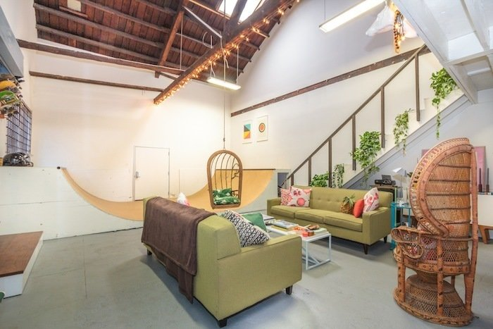 Modern Loft with Designer Halfpipe (Los Angeles, USA)  While the colorful, green-and-pink accents in this mid-century styled loft demand attention, it's hard for any furniture to overshadow the working half-pipe in the center of the 1,500-square-foot loft in Boyle Heights. While the outdoor patio and BBQ, accessible by a large roll-up door, strongly suggests grilling and evenings drinks al fresco, you may want to bring your deck just in case.  Listing at LA - Large Creative Skate Loft!  ZOLLAMT