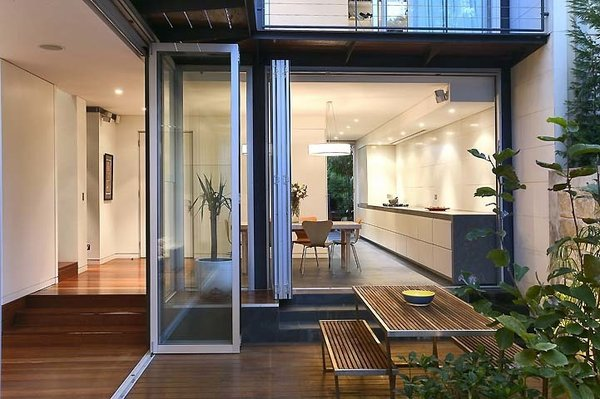Sleek Architect's Home (Sydney, Australia)  Providing a modern update to the predominantly Victorian style of surrounding suburban homes in Paddington, this urban home is bathed in natural light during the day and offers the respite of a Japanese garden on property.Listing at Architect's Own Central Sydney Home