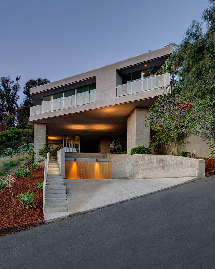 This cantilevered home by Escher GuneWardena Architecture in the Silver Lake neighborhood hovers above the sloping site, supported by five piers covered in vines. The architects sharply angled the street facade, offering views of the nearby lake. Photo by EGP Imaging.  Photo 15 of 21 in I Love Modern Architecture from Dwell on Design East Side Home Tour