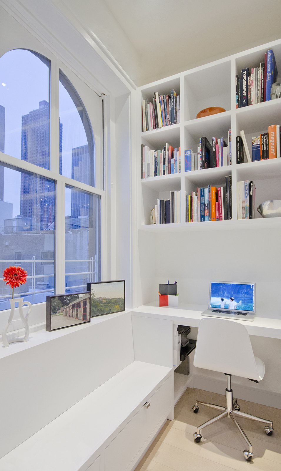 "The office nook, which was created out of a coat area, is the perfect setting to complete work assignments. ""The residents have a bench that they can put things in and sit atop when taking shoes off and on,"" Miller says.  A Renovated Tribeca Loft with a Modern Aesthetic by Monique Valeris"