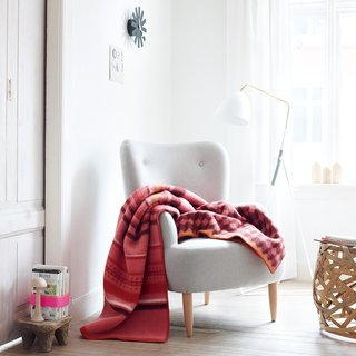 Cozy up with the Arv Throw from Røros Tweed. It blends centuries-old weaving techniques with modern geometric forms. It's the perfect complement to a lazy autumn morning.