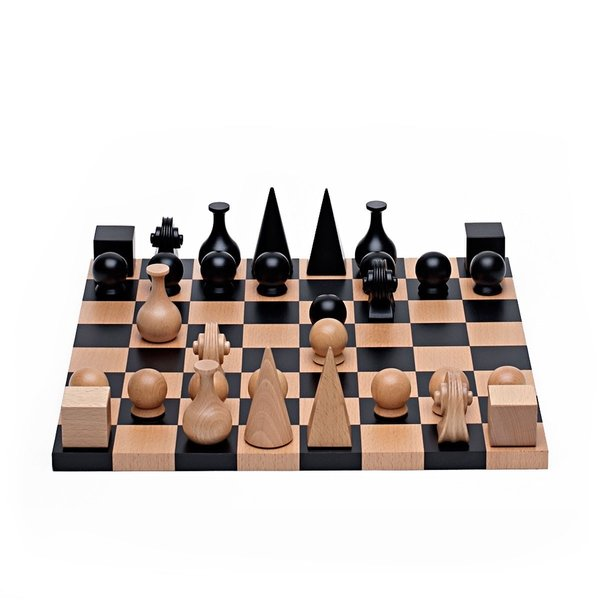 The seasonal change probably means more inside time, and we think there's no better way to pass the time than to play a classic game with family members and friends. This chess set came out of a lifelong friendship with chess enthusiast friends Marcel Duchamp and Man Ray. Man Ray creates this distinctive chess set in 1920, offering a personal interpretation of each character on the chess board: an Egyptian pyramid for the King, a medieval headdress for the Queen, a flask for the Bishop and the carved scroll of a violin for the Knight.