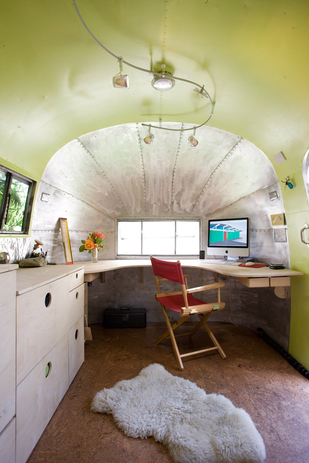 Office, Chair, Plywood Floor, and Desk The materials palette that I chose is light in color with a few splashes of color. This lightness holds the space open and gives it a contemporary feel.  Photos from The Airstream Life