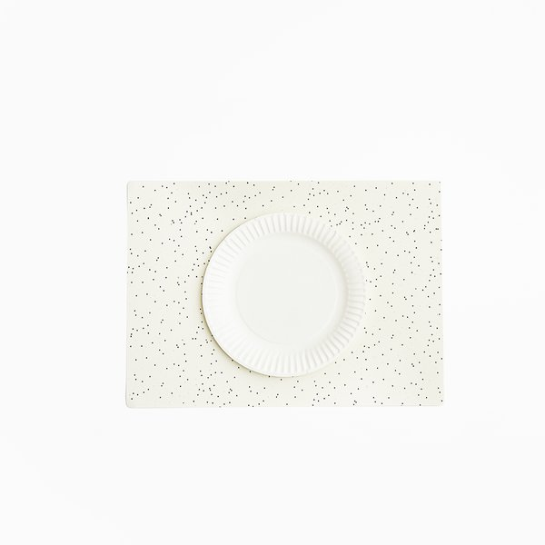 Paper Placements by Good Thing, $25 at workof.com  For casual hosts and hostesses, gift a 10-pack of graphic placemats, made in the USA from 100% recycled paper.