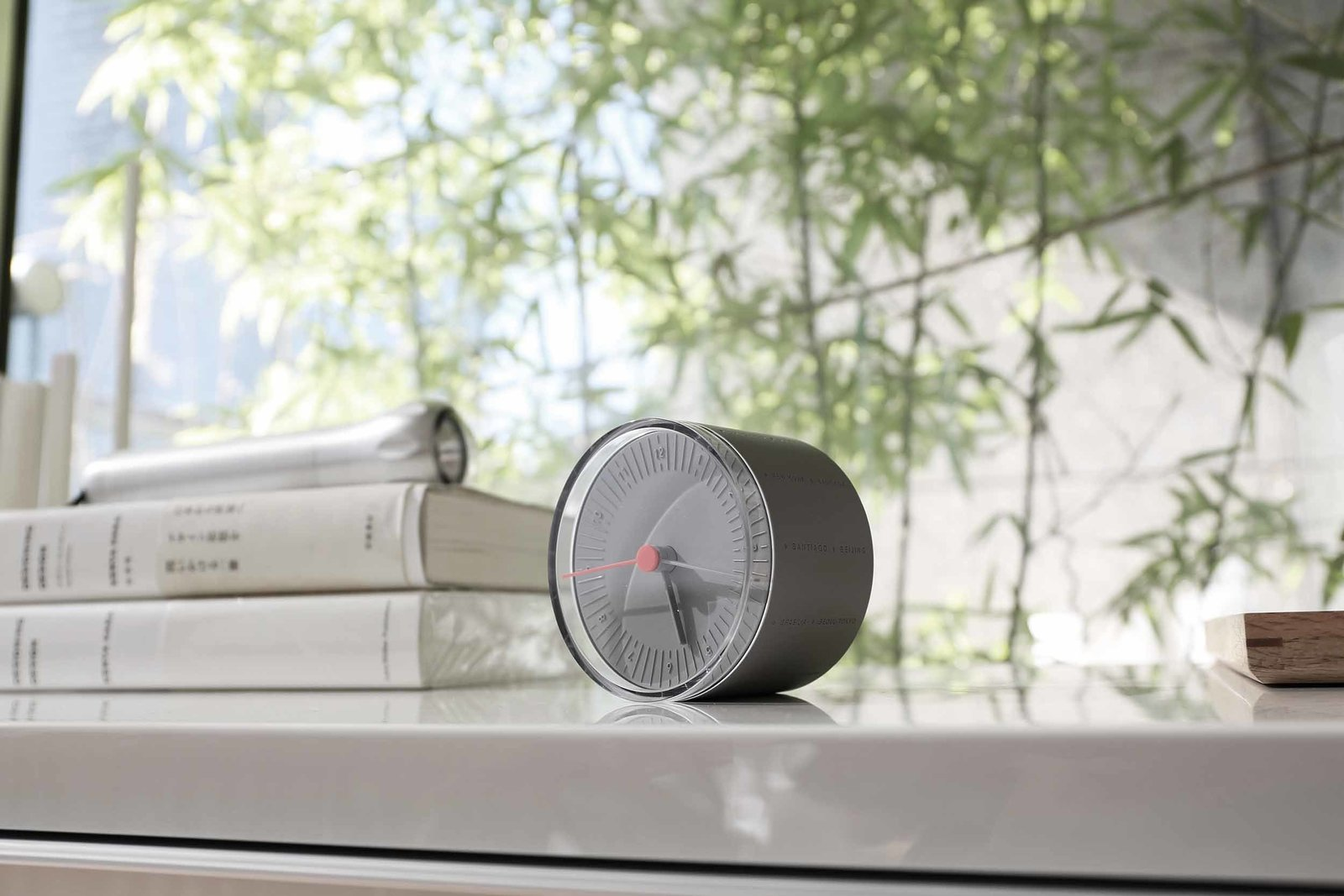 """11+ World Desk Clock designed by Yeongkyu Yoo for Leibal, $49 at store.dwell.com  This cylindrical desk clock is inscribed with names of different international cities, telling the time in each. All 24 time zones can be displayed, thanks to a distinctive rolling mechanism.  Search """"11plus world desk clock"""" from Editor's Picks: 10 Cheap but Cool Finds Under $50"""