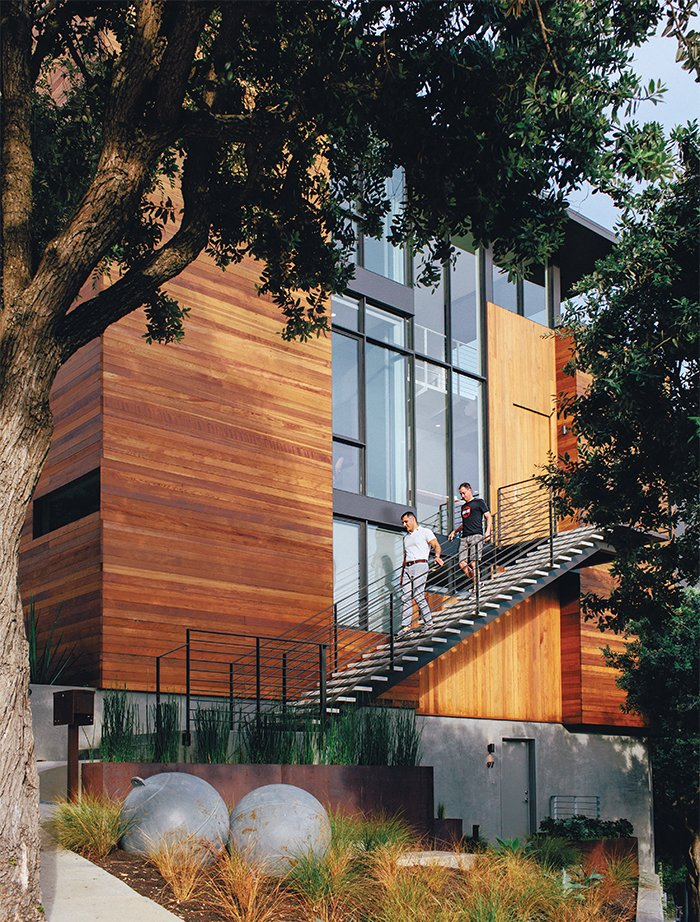 Exterior, House Building Type, and Wood Siding Material An existing home in San Francisco was renovated by architect George Bradley as his home with Eddie Baba, an attorney. The house was reconfigured to accommodate the entrance on the second floor, but the couple retained the in-law unit as a rental but shrunk it from two floors to one, creating space in which to carve out an office and a guest bedroom on the bottom floor of the main house.  Photo 3 of 19 in A Home with Eclectic Style Looks Just Right