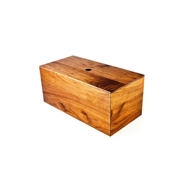 This Bread Box from On Our Table is a substantial piece that almost looks like a large block of wood. A small hole—designed to fit one's finger—lets you remove the lid, which has a similar profile to the box beneath. The roomy box is built to hold a large loaf of bread, but it can also be used to hold other kitchen items.