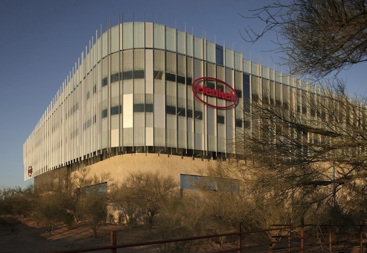"""Henkel North American Consumer Products Headquarters (Scottsdale, Arizona: 2010)  Building in the Sonoran desert doesn't immediately bring the word """"sustainable"""" to mind. This 348,000-square-foot Scottsdale office space for Henkel, a German consumer goods company, is a stylish rejoinder to that impression. Here, nature is put to work. The roof is covered in a 1.5-acre garden of native plants, with solar panels that power the building's banks of washers and dryers, a substantial green gesture for a company that makes laundry detergent. And the exterior, designed by CH2M Hill and Will Bruder + Partners, features custom glass etched in a pattern that reduces the intensity of the sunlight and a breathable skylight over the central atrium. Turning down the heat only seems fitting for the makers of a successful line of deodorants.   Photo by Henkel  Photo 2 of 10 in 10 Green Commercial Buildings"""
