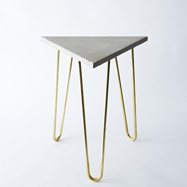 Zelda Table by Brooklyn-based designer Katy Skelton. This refined industrial table is made of solid brass hairpin legs paired with an engineered concrete top.