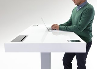 "Kinetic Desk by Stir  Already a tech darling, this adjustable height productivity tool could be called the quantified desk. It aims to make the phrase ""tied to your desk"" a good thing; with Fitbit connectivity, a smooth user interface and a ""whisper breath system"" that bumps the surface up to encourage more standing, it's the high-tech solution to the health issues that come from sitting behind a screen all day. CEO and ex-Apple engineer JP Labrosse wanted to create something that invites people to move with subtle engagement and create products that ""support people's best work."" (For more flexible office solutions, read Dwell's June 2014 essay on the changing workplace.)  Photo by Stir"