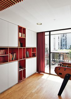 Brambilla designed and crafted the built-in bookcase in a common area from laminated red birch.