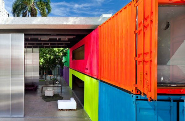 Decameron (Sao Paulo, Brazil)  Brazilian architect Marcio Kogan turned an empty urban alley into a neon-drenched retreat, complete with a small garden, by repurposing shipping containers.   Photo by Pedro Vannucchi