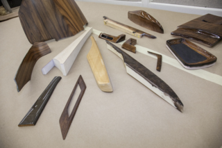 Here's an example of all various wood accents one might see within a car. After the shape is contoured and refined by the designers and woodworkers—the same way as the steering wheel stitch is—it's then ok'd for production.  This is just a glimpse of what goes into three components and similar processes occur for other parts.