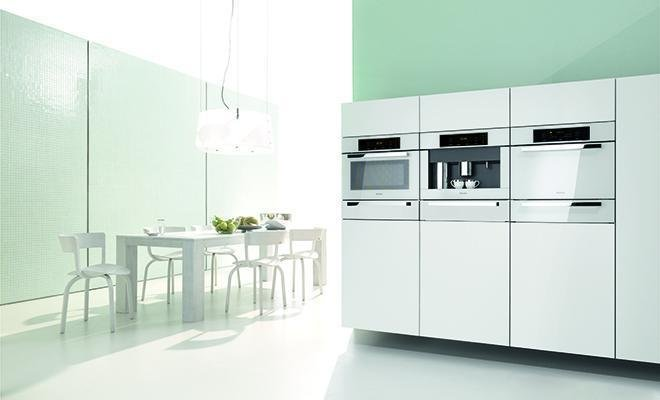 """Immer Besser—meaning """"Forever Better""""—is Miele's motto. The Brilliant White Collection features sleek built-in appliances: convection, steam, and speed ovens, plus a whole bean coffee system and a plate- and cup-warmer.  Kitchen Products at Dwell on Design  by Izzie Panasci"""
