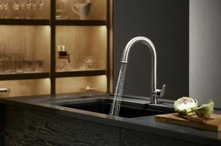 Kohler's simple designs make for a more efficient cooking experience. Case in point? The brand's Sensate touchless faucet that enables easy hand-washing.