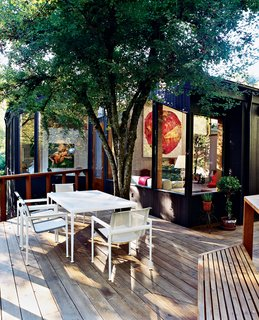 Watson, who works from home when he's not traveling, likes to use the back patio as his office during warmer months. In choosing patio furniture, he decided on a reversal of the interior color palette: A rectangular white metal table and chairs by Richard Schultz are durable but refined while contrasting with the cedar deck.