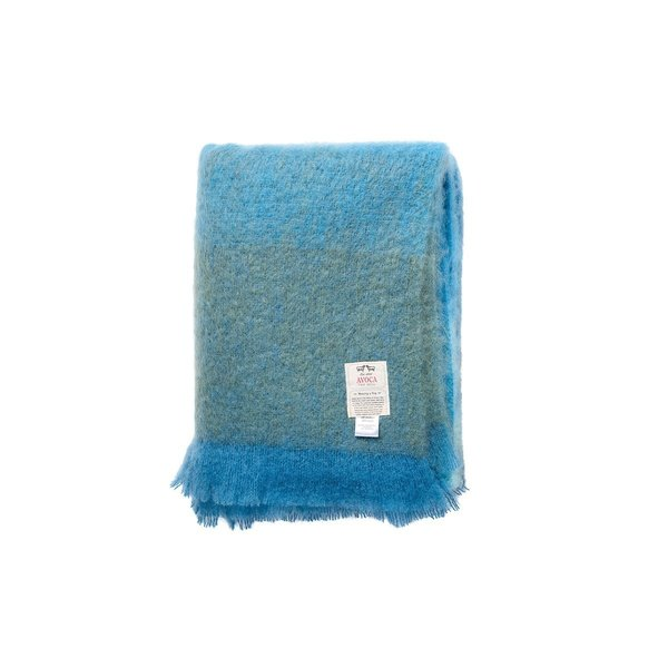 Steeped in the tradition of the nearly 300-year-old Irish company, this throw blanket is comprised of approximately 400 threads that have been lined up and tied by hand. Both lightweight and warm, the Ombre Throw from Avoca is perfect to wrap yourself in with a cup of tea or a good book.