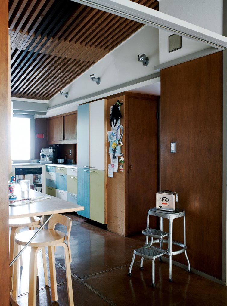 To temper the house's warm tones, the couple opted for cool cabinet facings in   the kitchen.  Photo 1 of 9 in Oakland Aesthetics