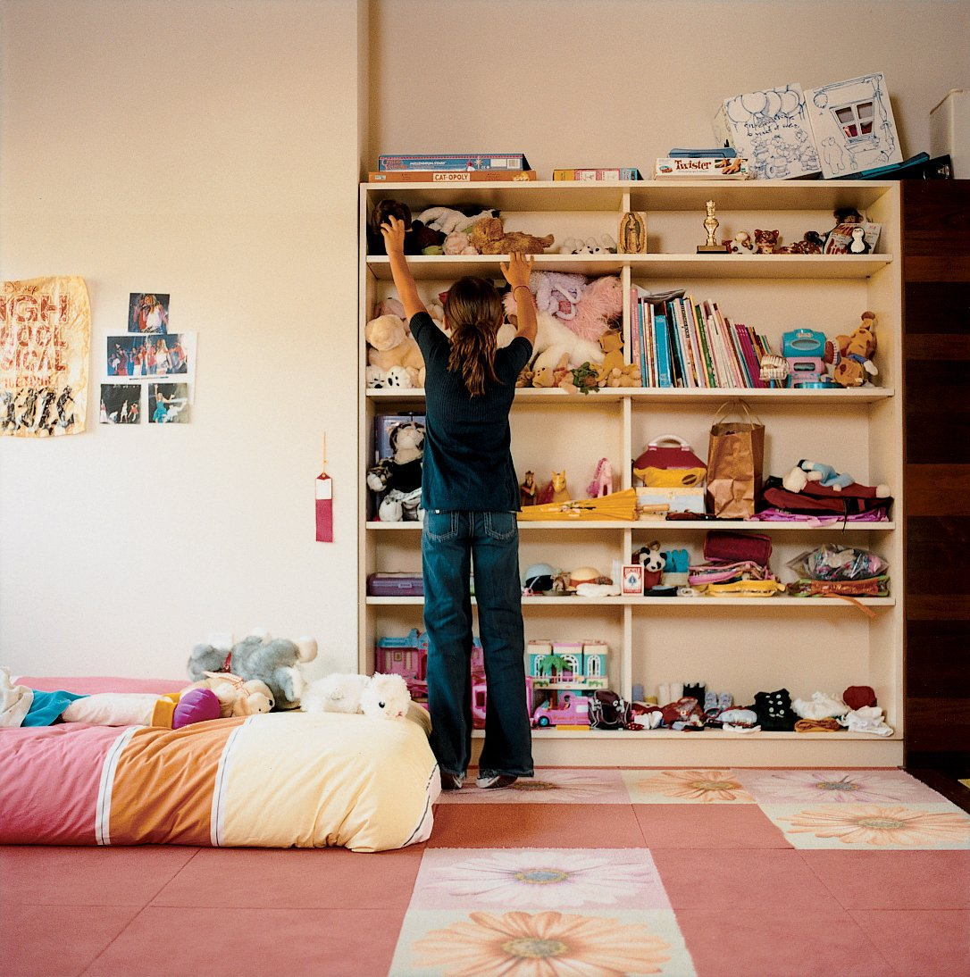 Kids Room, Shelves, Bedroom Room Type, Bed, Carpet Floor, and Girl Gender Olivia's bedroom.  Photo 5 of 8 in 7 Ways to Child-Proof Your Home Without Forgoing Style from Double the Pleasure