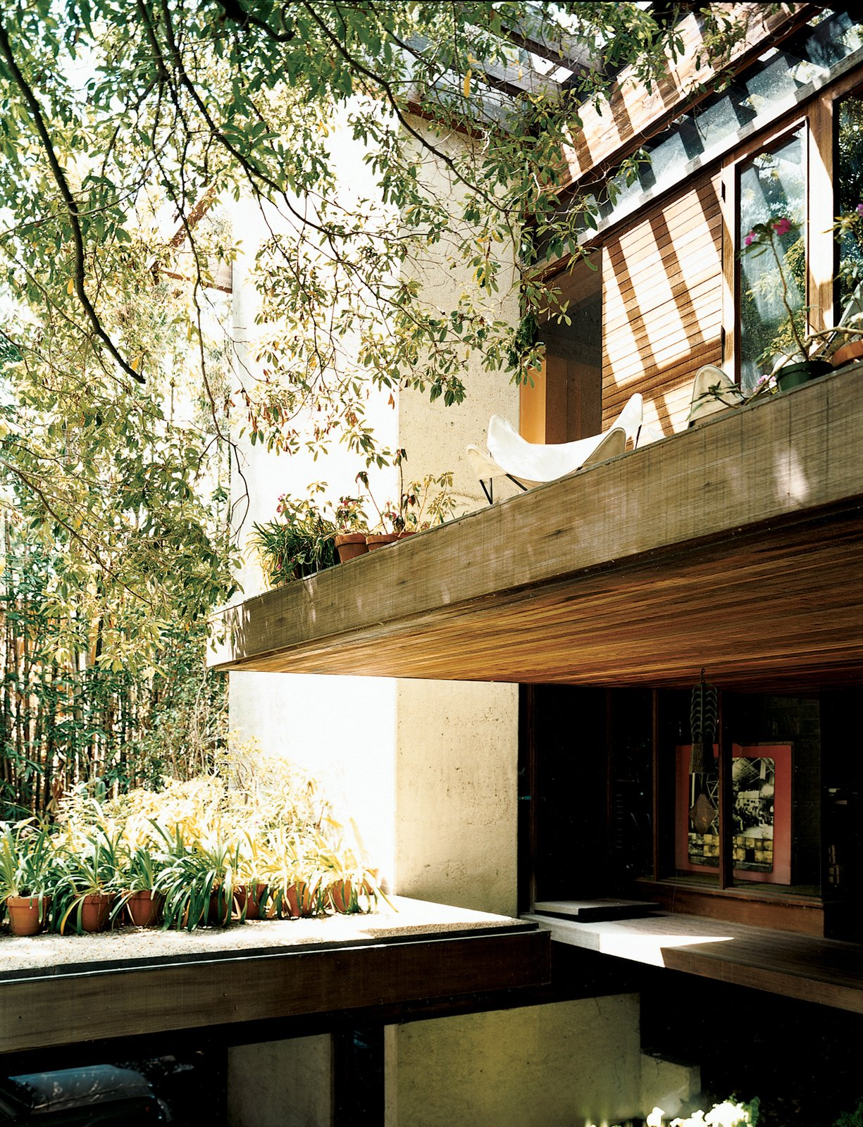 "Exterior The front door is tucked under a cantilevered terrace.  Search ""5 gravity defying cantilevers"" from Ray Kappe-Designed Multilevel House in Los Angeles"