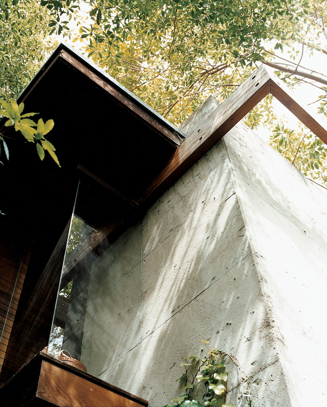 This detail shows the conjunction of concrete with wooden beams, where flush glass windows angle outward to the canopies of nearby trees. The detail also encapsulates Ray's vision for the house: a synthesis of the rational and the intuitive.  Photo 10 of 12 in Ray Kappe-Designed Multilevel House in Los Angeles