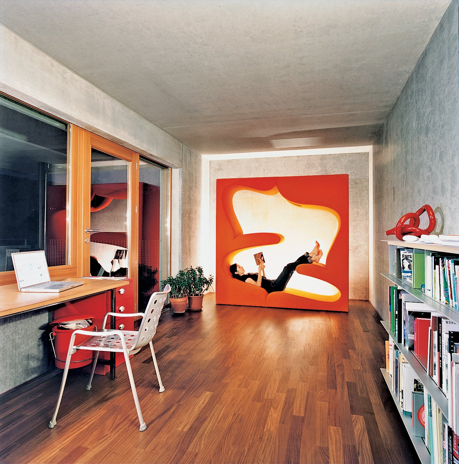 Living Room, Medium Hardwood Floor, and Recliner The office includes the Living Tower designed by Verner Panton for Vitra.  Home Offices and Workspaces We Love from Swiss Mix