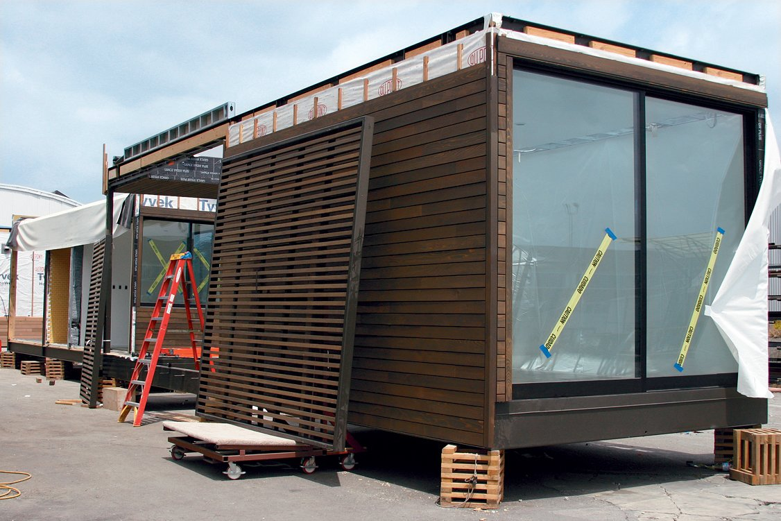 Modules receive finishing touches before they are prepared for shipment.  Marmol Radziner Prefab by Jessica Hundley